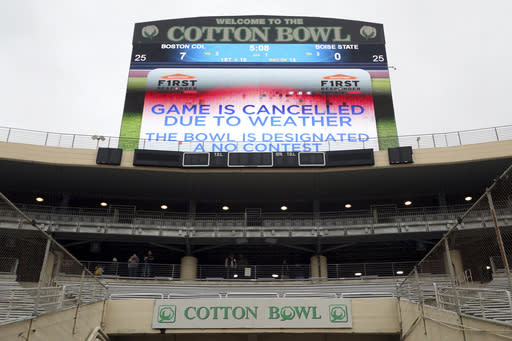 The First Responder Bowl between Boston College and Boise State was cancelled due to weather and was designated a no contest after multiple lighting delays Wednesday, Dec. 26, 2018, in Dallas. (AP Photo/Richard W. Rodriguez)