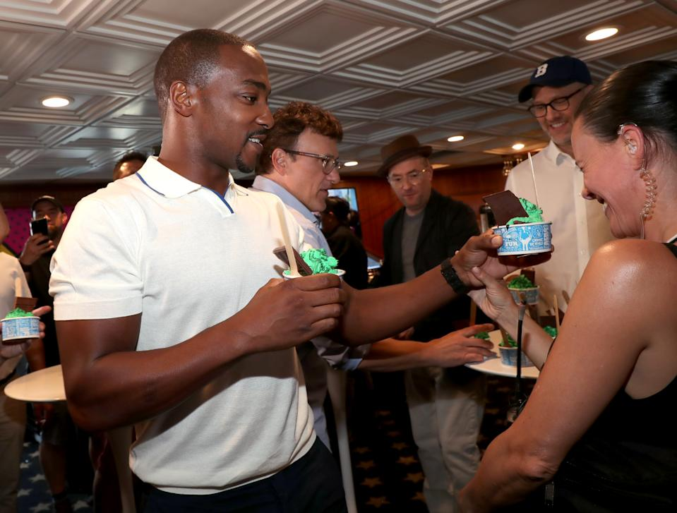 SAN DIEGO, CALIFORNIA - JULY 20: Anthony Mackie, Anthony Russo, Christopher Markus and Stephen McFeely are seen with a fan at the #IMDboat at San Diego Comic-Con 2019: Day Three at the IMDb Yacht on July 20, 2019 in San Diego, California. (Photo by Rich Polk/Getty Images for IMDb)