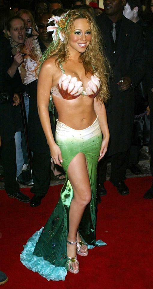 "<p>At her 2003 NYC bash, <a class=""sugar-inline-link ga-track"" title=""Latest photos and news for Mariah Carey"" href=""https://www.popsugar.com/Mariah-Carey"" target=""_blank"" data-ga-category=""Related"" data-ga-label=""https://www.popsugar.com/Mariah-Carey"" data-ga-action=""&lt;-related-&gt; Links"">Mariah Carey</a> wore a mermaid costume with metallic green makeup and beachy curls.</p>"