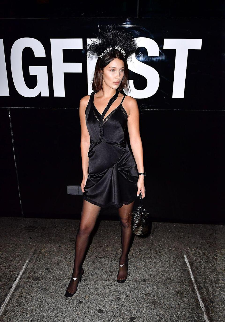 <p>In a black slip dress and party animal headband while out in New York City.</p>
