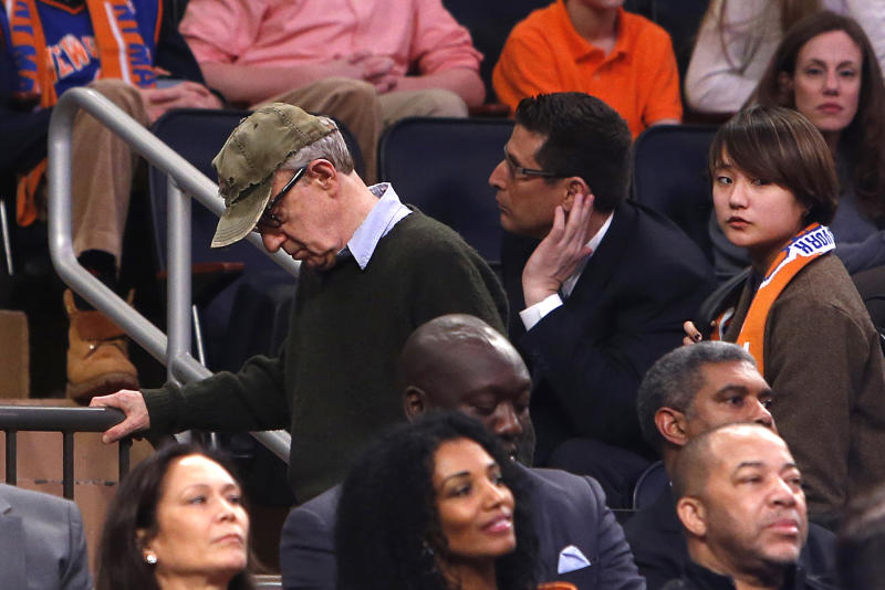 Filmmaker Woody Allen, left, leaves late in the fourth quarter of an NBA basketball game between the Miami Heat and the New York Knicks Saturday, Feb. 1, 2014, in New York. Miami won 106-91. (AP Photo/Jason DeCrow)