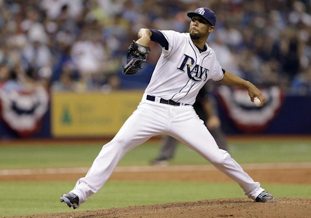 Tampa Bay Rays starting pitcher David Price delivers to the Toronto Blue Jays during the fourth inning of a baseball game Monday, March 31, 2014, in St. Petersburg, Fla. (AP Photo/Chris O'Meara)