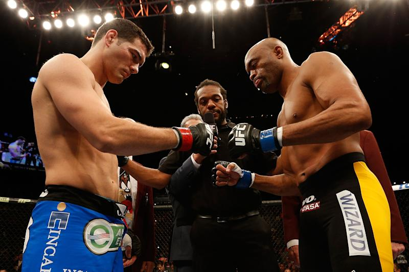 LAS VEGAS, NV - DECEMBER 28: (L-R) Chris Weidman and Anderson Silva touch gloves before their UFC middleweight championship bout during the UFC 168 event at the MGM Grand Garden Arena on December 28, 2013 in Las Vegas, Nevada. (Photo by Josh Hedges/Zuffa LLC/Zuffa LLC via Getty Images)