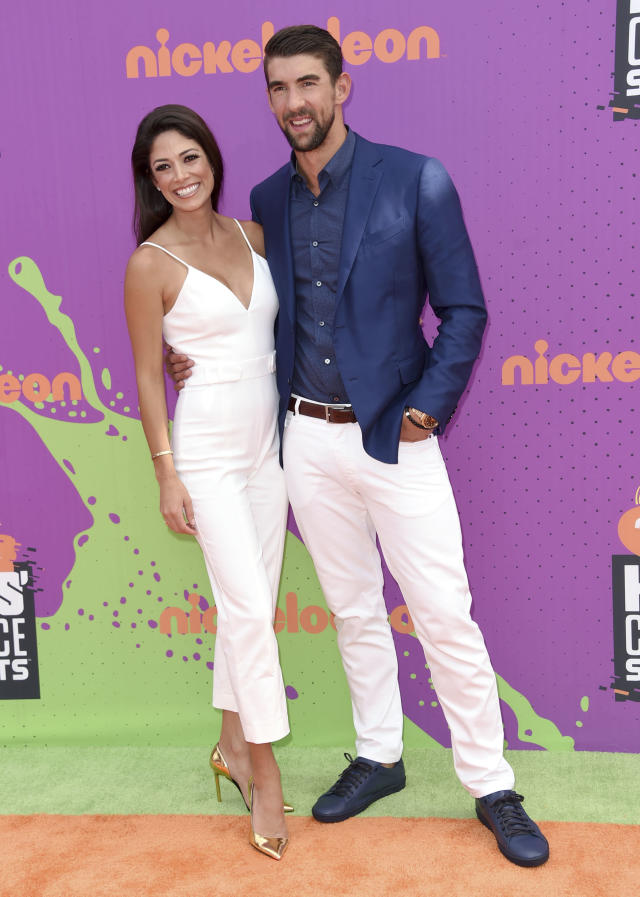 Retired Olympic swimmer Michael Phelps, right, and Nicole Johnson arrive at the Kids' Choice Sports Awards at UCLA's Pauley Pavilion on Thursday, July 13, 2017, in Los Angeles. (Photo by Richard Shotwell/Invision/AP)