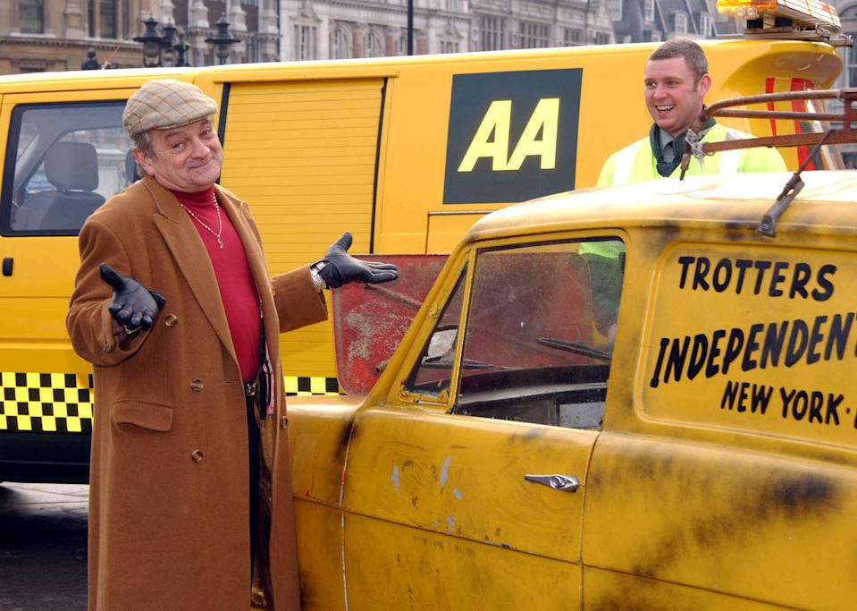 Britain's favourite wheeler dealer 'Del Boy' (left) (or his lookalike Maurice Canham) and AA man Scott Tuccman with the three-wheel van from BBC's 'Only Fools and Horses' in Trafalgar Square, London.   *  'Del Boy' helped to launch the AA's commercial car purchasing scheme, AA 'Buyacar'.   (Photo by Andy Butterton - PA Images/PA Images via Getty Images)