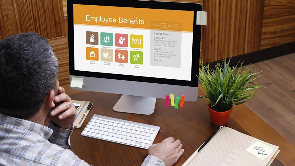man reviewing his employer benefits
