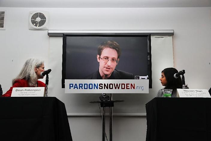 Edward Snowden speaks via video link at a news conference for the launch of a campaign calling for President Obama to pardon him on September 14, 2016 in New York City (AFP Photo/Spencer Platt)