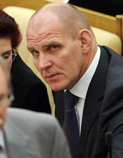 "Russian lawmaker, ruling United Russia Party member, three-time Russian Olympic champion Alexander Karelin, former wrestler, listens during a parliament session in Moscow, Wednesday, Feb. 13, 2013. Karelin noted in an interview with Vyes' Sport that Russians and Soviets have won 77 gold medals. ""It's understandable that a lot of people didn't like this,"" Karelin said. ""I'm not a supporter of conspiracy theory, but it seems to me that the underlying cause here is obvious."" While wrestling will be included at the 2016 Olympics in Rio de Janeiro, it was cut from the games in 2020, which have yet to be awarded to a host city. (AP Photo)"