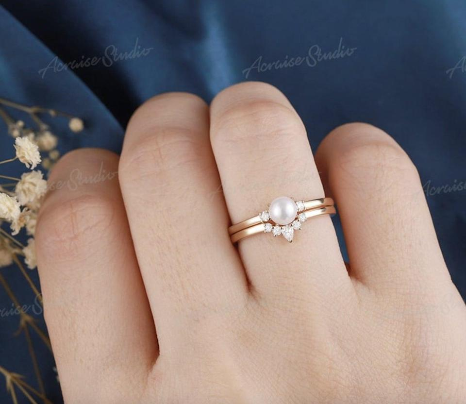<p>This <span>Vintage Pearl Engagement Ring Set</span> ($441 and up) has a unique timeless look.</p>