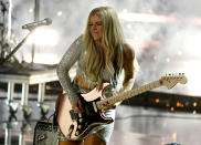 """Lindsay Ell performs """"Like A Lady"""" at the CMT Music Awards at the Bridgestone Arena on Wednesday, June 9, 2021, in Nashville, Tenn. (AP Photo/Mark Humphrey)"""