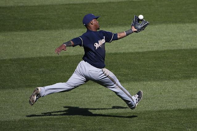 Milwaukee Brewers shortstop Jean Segura (9) catches a fly ball by Pittsburgh Pirates' Chris Stewart in short center field during the ninth inning of a baseball game in Pittsburgh Sunday, April 20, 2014. The Brewers won in 14 innings 3-2. (AP Photo/Gene J. Puskar)
