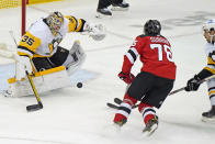 New Jersey Devils defenseman P.K. Subban (76) shoots against Pittsburgh Penguins goaltender Tristan Jarry (35) during the third period of an NHL hockey game, Sunday, April 11, 2021, in Newark, N.J. Subban scored seconds later, although the play had to be reviewed. (AP Photo/Kathy Willens)