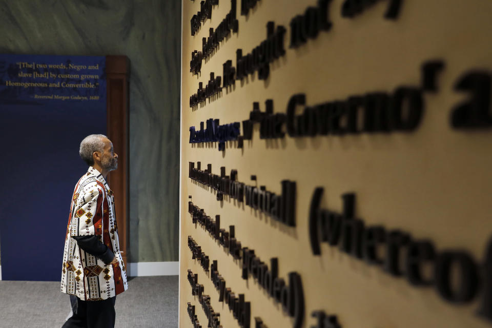 FILE - In this Aug. 24, 2019 file photo, Jerome Jones explores inside the Fort Monroe Visitor And Education Center during the First African Landing Commemorative Ceremony at Fort Monroe, Va. Officials observed the arrival of enslaved Africans 400 years earlier to what is now Virginia. Proposals in Arkansas, Iowa and Mississippi would prohibit schools from using a New York Times project that focused on slavery's legacy. (Jonathon Gruenke/The Daily Press via AP)