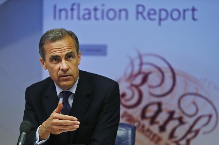 Governor of the Bank of England Mark Carney addresses a news conference in London on May 14, 2014