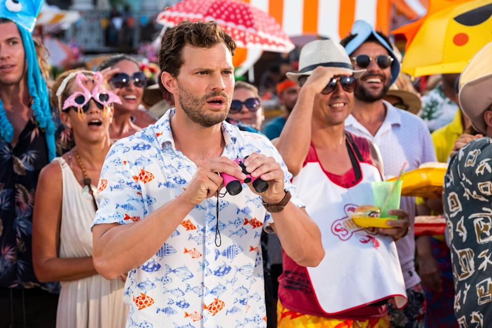 """Playing Edgar in """"Barb & Star Go to Vista Del Mar,"""" Jamie Dornan got to wear a whole lot of Hawaiian shirts. """"The fitting was very fun because I loved everything I put on,"""" he says. """"I only ended up with one (Hawaiian shirt). It has a fish on it. Come the summer, I'll rock that."""""""
