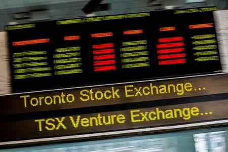 FILE PHOTO: A sign board displaying Toronto Stock Exchange stock information is seen in Toronto