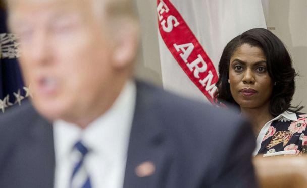 PHOTO: Omarosa Manigault (R), White House Director of Communications for the Office of Public Liaison, sits behind President (Saul Loeb/AFP/Getty Images FILE)