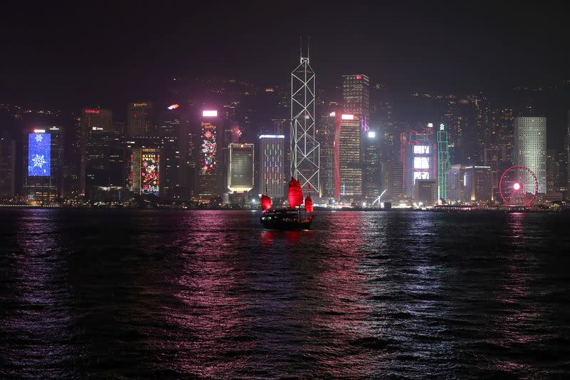 FILE PHOTO: The Hong Kong skyline is lit up on Christmas Eve in Hong Kong