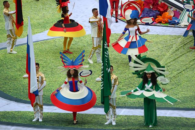 <p>MOSCOW, RUSSIA – JUNE 14: The Russia and Saudi Arabia flags are paraded at the opening ceremony prior to the 2018 FIFA World Cup Russia group A match between Russia and Saudi Arabia at Luzhniki Stadium on June 14, 2018 in Moscow, Russia. (Photo by Robbie Jay Barratt – AMA/Getty Images) </p>