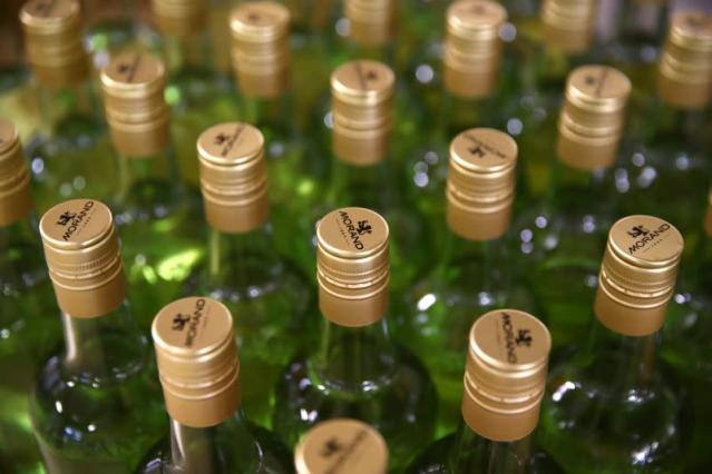 Bottles of pear and mint alcohol are pictured at Swiss distiller Morand in Martigny