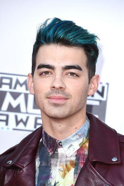 <p>Jonas went blue after his breakup with Gigi Hadid and we give the look two thumbs up. <i>(Photo: Getty Images)</i></p>