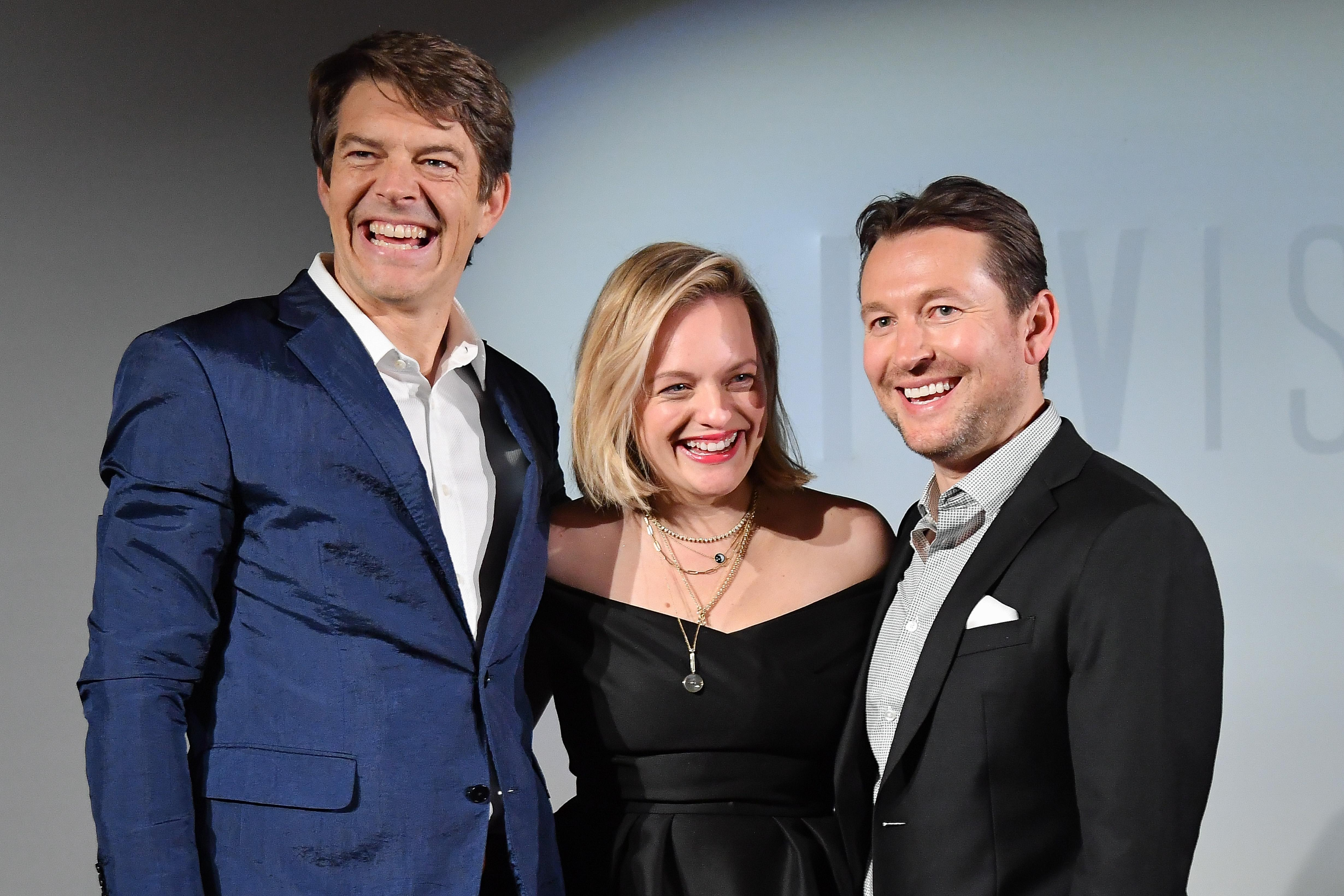 "PARIS, FRANCE - FEBRUARY 17: (L to R) Jason Blum, Elisabeth Moss and Leigh Whannell attend the ""Invisible Man"" premiere at Gaumont Champs ELysees on February 17, 2020 in Paris, France. (Photo by Stephane Cardinale - Corbis/Corbis via Getty Images)"