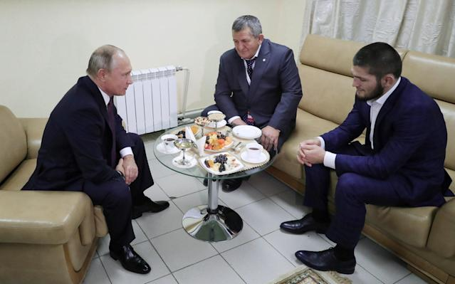 Russian President Vladimir Putin (L) meets with mixed martial arts fighter Khabib Nurmagomedov of Russia (R), UFC lightweight champion who recently defeated Conor McGregor of Ireland in the main event of UFC 229, and his father Abdulmanap Nurmagomedov on the sidelines of a sports forum in Ulyanovsk, Russia October 10, 2018. Sputnik/Mikhail Klimentyev/Kremlin via REUTERS ATTENTION EDITORS - THIS IMAGE WAS PROVIDED BY A THIRD PARTY.