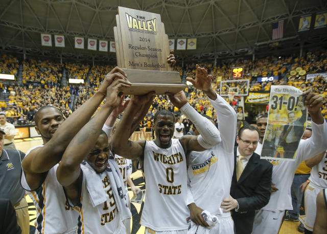 Wichita State players hold up the Missouri Valley Conference regular season trophy after beating Missouri State 68-45 in an NCAA college basketball game in Wichita, Kansas., Saturday, March 1, 2014. (AP Photo/The Wichita Eagle, Travis Heying)