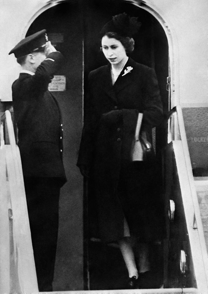 <p>Dressed in black, Queen Elizabeth II sets foot on British soil for the first time since her accession. (PA) </p>