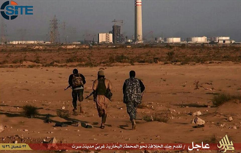 Image taken from jihadist media outlet Wilayat Trablus and provided by US-based monitoring agency SITE Intelligence Group on June 9, 2015 allegedly shows IS group fighters in the eastern Libyan city of Sirte (AFP Photo/)