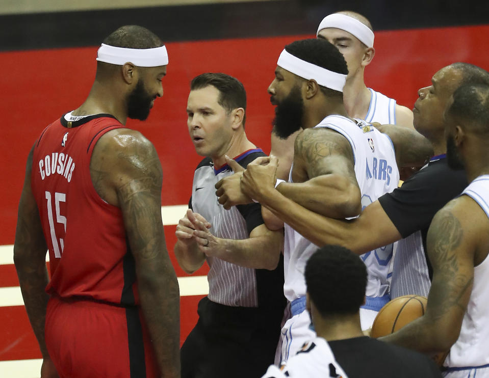 Los Angeles Lakers forward Markieff Morris, right, gets into an altercation with Houston Rockets center DeMarcus Cousins.