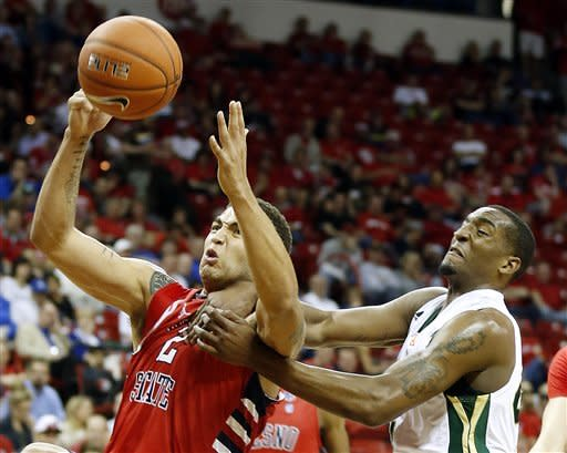 Fresno State's Braeden Anderson, left, and Colorado State's Greg Smith try to pull down a rebound during the second half of a Mountain West Conference tournament NCAA college basketball game on Wednesday, March 13, 2013, in Las Vegas. Colorado State defeated Fresno State 67-61. (AP Photo/Isaac Brekken)