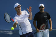 Andy Murray, left, of Britain, practices as his coach Jamie Delgado, right, at the Western & Southern Open tennis tournament, Sunday, Sunday, Aug. 11, 2019, in Mason, Ohio. (AP Photo/John Minchillo)
