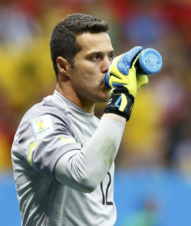 Brazil's goalkeeper Julio Cesar takes a drink during their 2014 World Cup third-place playoff against the Netherlands at the Brasilia national stadium in Brasilia July 12, 2014. REUTERS/Dominic Ebenbichler (BRAZIL - Tags: SOCCER SPORT WORLD CUP)