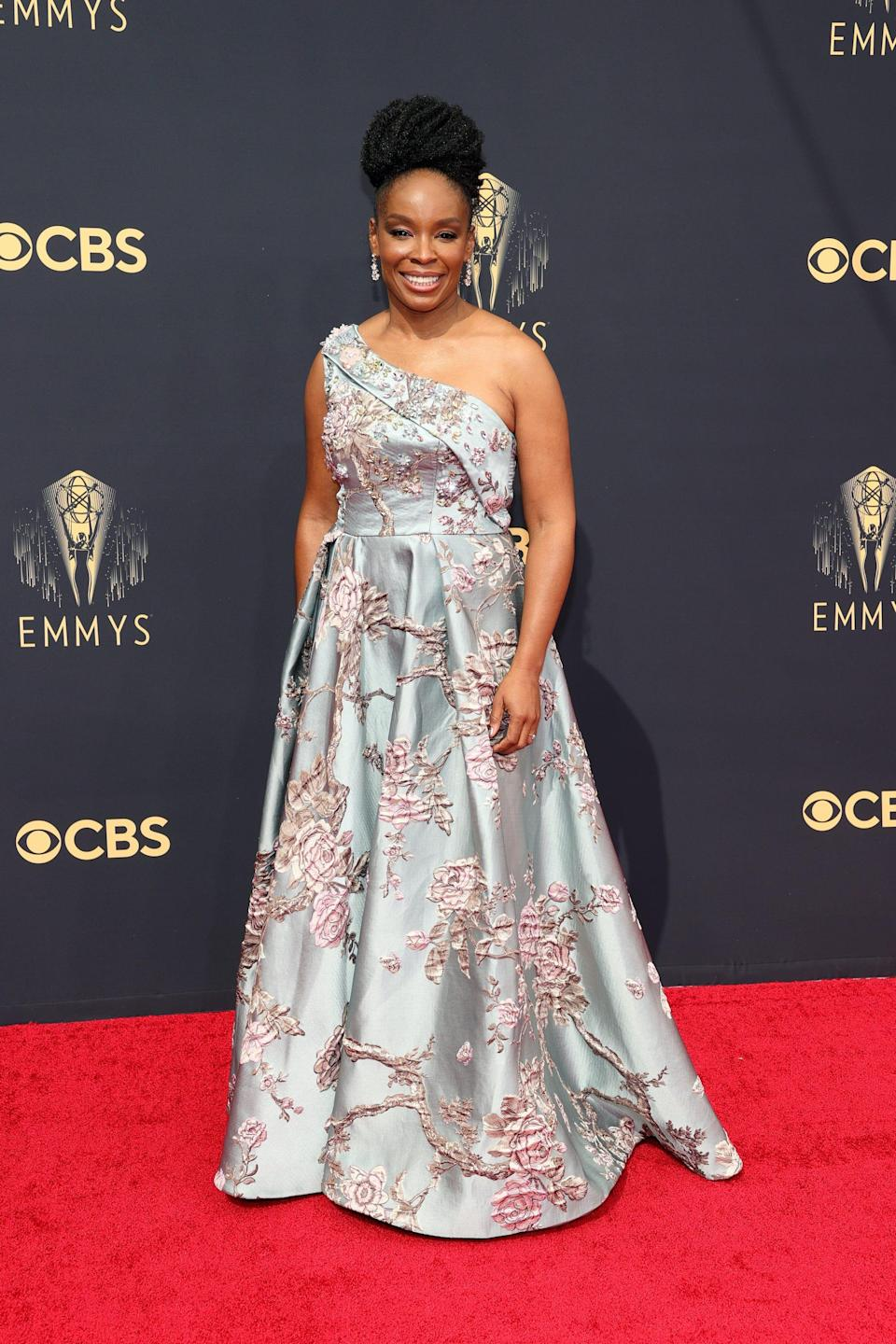 Amber Ruffin wears a one-strap dress on the Emmys red carpet.