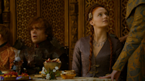 <p>At Joffrey's ill-fated wedding, Sansa is still wearing her signature dark purple-a sign that she wasn't expecting her life to change that day. </p>