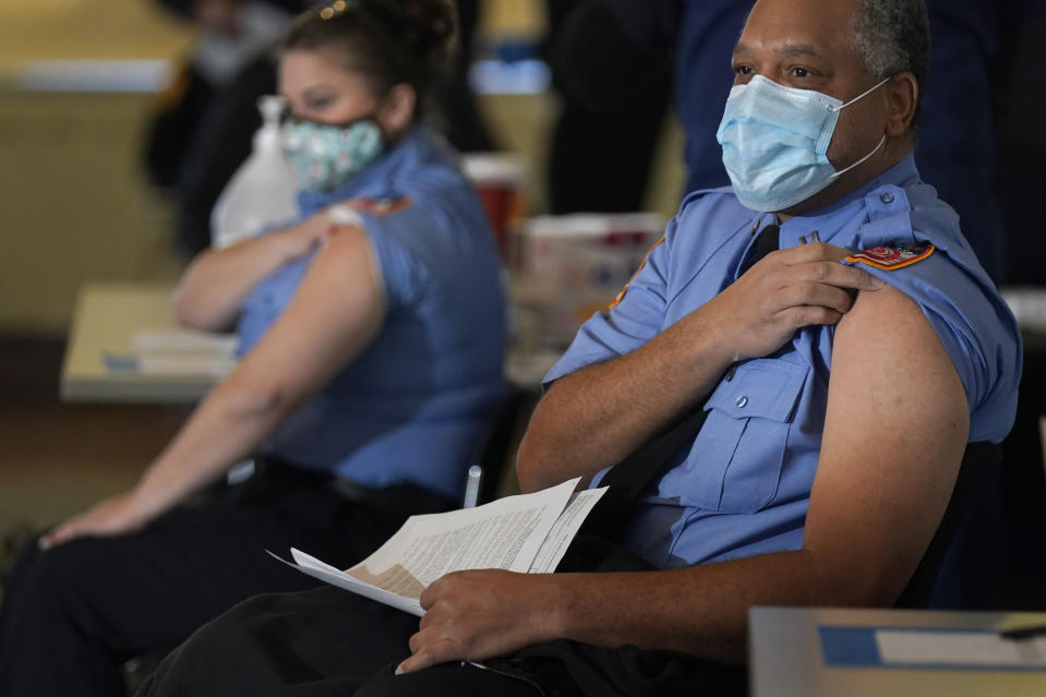 New York City firefighter emergency medical services personnel are vaccinated against COVID-19 at the FDNY Fire Academy in New York, Wednesday, Dec. 23, 2020. (AP Photo/Seth Wenig)