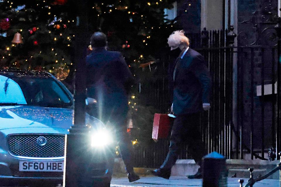 <p>Boris Johnson leaves to catch his flight to Brussels</p>AFP via Getty Images