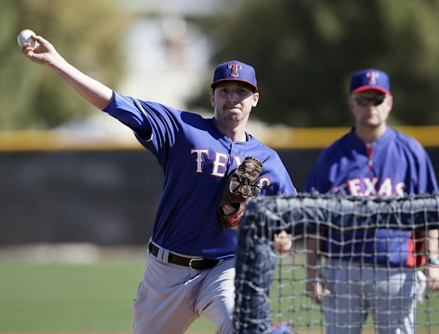 Texas Rangers' Tanner Scheppers throws during batting practice for spring training baseball practice, Monday, Feb. 17, 2014, in Surprise, Ariz. (AP Photo/Tony Gutierrez)