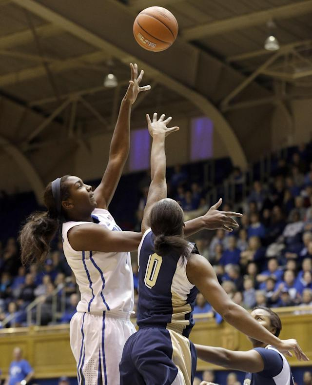 Duke's Elizabeth Williams shoots over Pittsburgh's Asia Logan (0) during the first half of an NCAA college basketball game in Durham, N.C., Sunday, Jan. 26, 2014. (AP Photo/Gerry Broome)