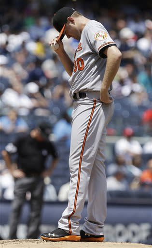 Baltimore Orioles starting pitcher Chris Tillman reacts after New York Yankees' Luis Cruz hit an RBI single during the second inning of a baseball game Saturday, July 6, 2013, in New York. (AP Photo/Frank Franklin II)