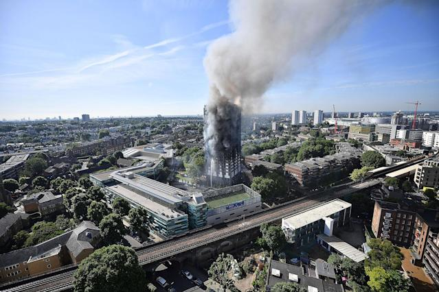 <p>JUN. 14, 2017 – Smoke rises from the building after a huge fire engulfed the 24 storey residential Grenfell Tower block in Latimer Road, West London in the early hours of the morning in London, England. The fire claimed more than 70 lives and left hundreds homeless. (Photo: Leon Neal/Getty Images) </p>
