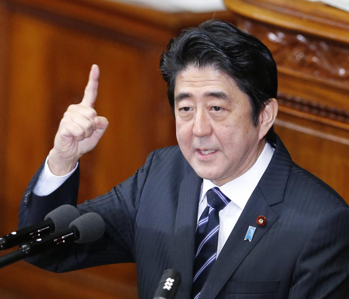 "Japanese Prime Minister Shinzo Abe gestures as he gives his policy speech during an opening session at the lower house of parliament in Tokyo, Monday, Jan. 28, 2013. Abe whose government faces stiff challenges in reviving the economy and managing an escalating dispute with China over an island chain in the East China Sea said ""Let us have strong determination to regain a powerful economy."" Abe also said, ""We will take every measure to promote and manage and we will give our best efforts to guard the remote islands at the borders."" (AP Photo/Koji Sasahara)"