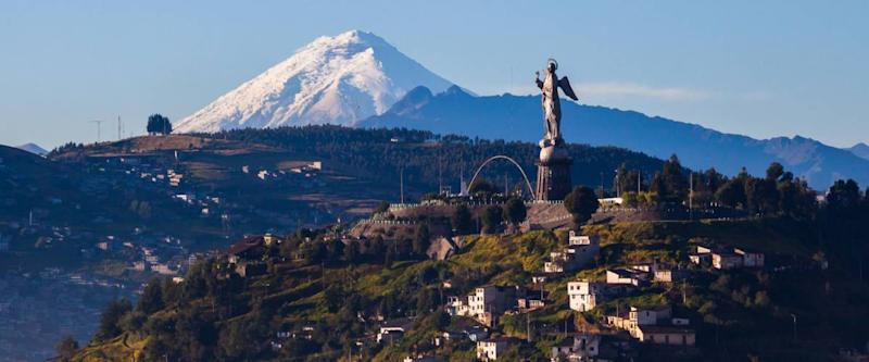 View of El Panecillo in the center of Quito with the Cotopaxi in the background