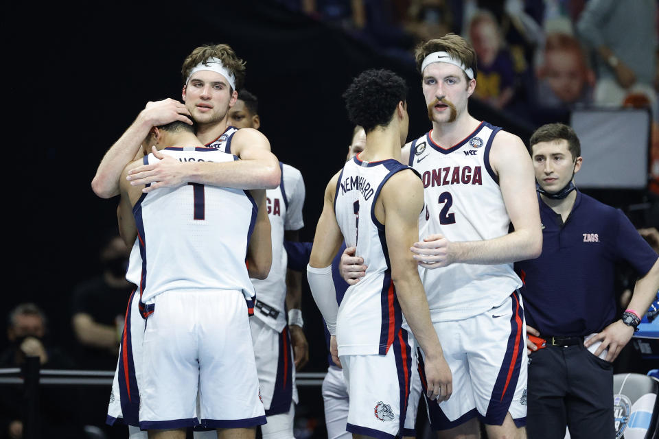 Gonzaga's Jalen Suggs (L), Corey Kispert, Andrew Nembhard and Drew Timme react after losing the national championship game on Monday. (Tim Nwachukwu/Getty Images)