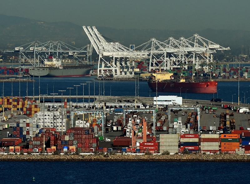 Ships wait to be loaded at the Port of Los Angeles in Long Beach, California (AFP Photo/MARK RALSTON)