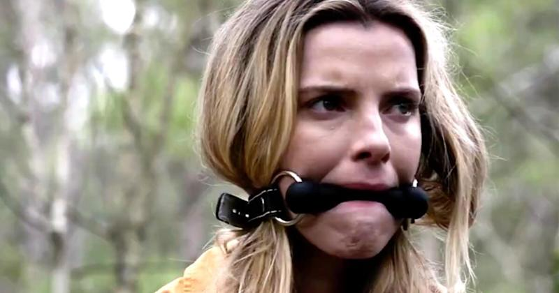 GLOWstar Betty Gilpin becomes human prey in first The Hunttrailer