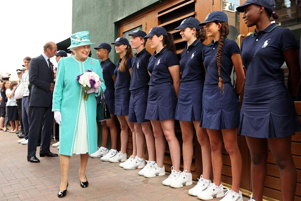 <p>Queen Elizabeth II visits with the ball boys and girls.</p>