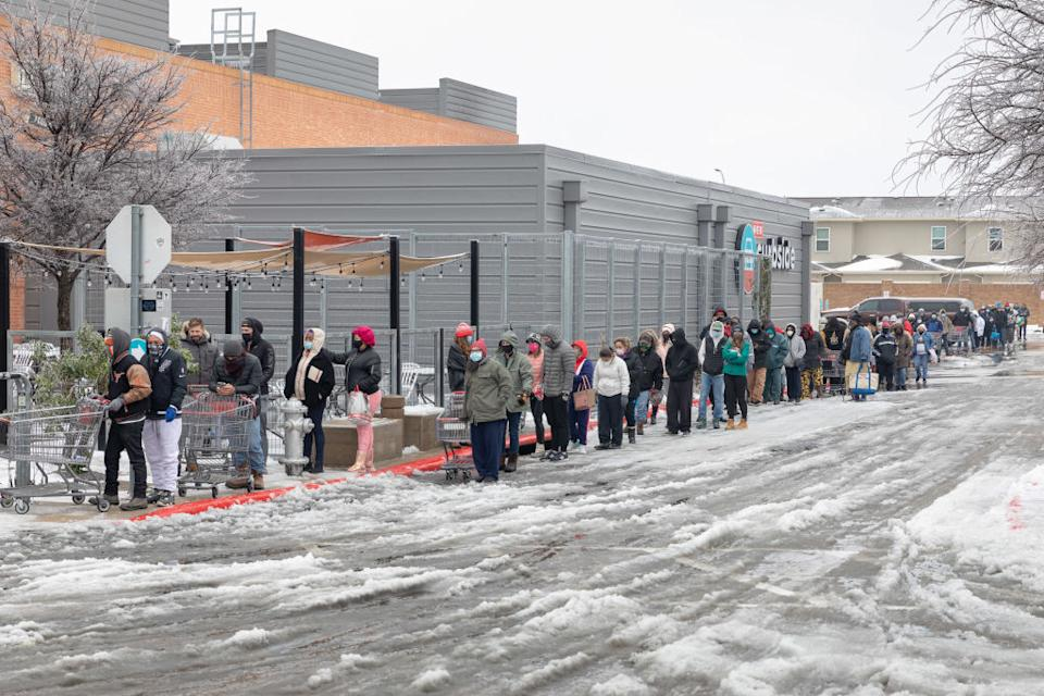 People wait outside a supermarket in freezing temperatures in Texas.
