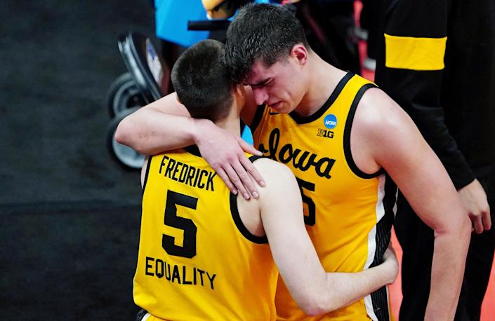 Mar 22, 2021; Indianapolis, Indiana, USA; Iowa Hawkeyes center Luka Garza (55) and guard CJ Fredrick (5) react after their loss to the Oregon Ducks in the second round of the 2021 NCAA Tournament at Bankers Life Fieldhouse. The Oregon Ducks won 95-80. Mandatory Credit: Kirby Lee-USA TODAY Sports